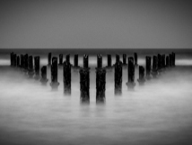 Pilings in the sea by dannypo